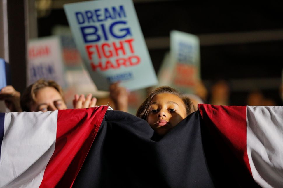 A young supporter at the final event of Elizabeth Warren's campaign, in Detroit on Super Tuesday.