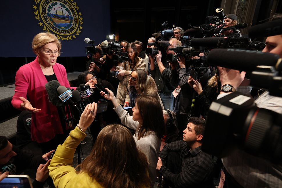 Elizabeth Warren speaks to reporters following a town hall in Keene, New Hampshire, in the run-up to the state's primar