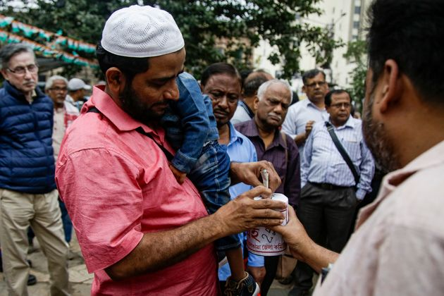 Supporters of Communist Party of India-Marxist (CPI-M) collect funds for victims affected during the...