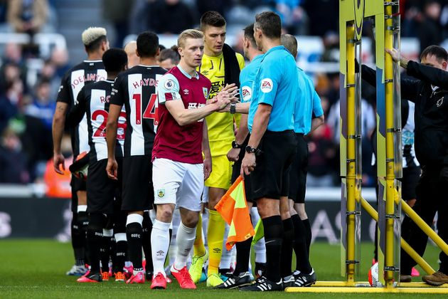 NEWCASTLE UPON TYNE, ENGLAND - FEBRUARY 29: Players and officials shake hands amid Coronavirus concerns...