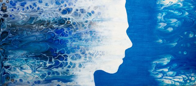 Abstract painting with liquid acrylic. Profile of the girl from the sea foam. -