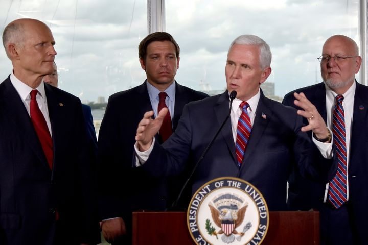 Vice President Mike Pence, center, along with Florida Sen. Rick Scott, far left, and Gov. Ron DeSantis, left, and CDC Directo