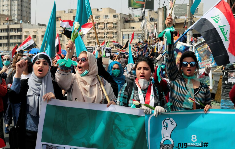 Protesters move through the streets of Baghdad, Iraq to mark International Women's