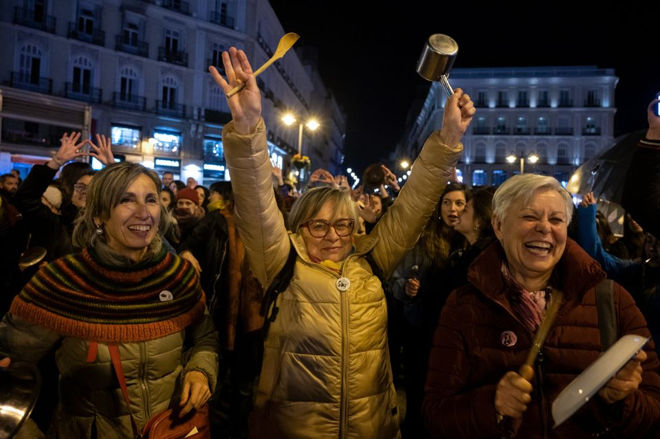 Women making noise hitting pots and pans protesting in Sol Square, Madrid, Spain. to mark the start of...