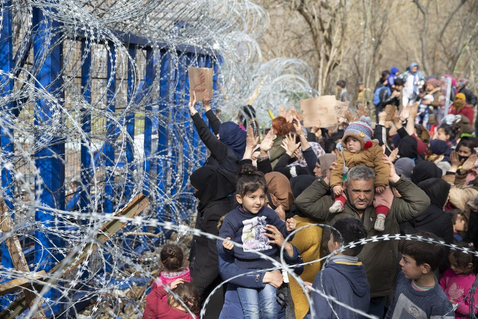 Asylum Seekers, mostly women, waiting at Turkey's Pazarkule border crossing to reach Europe, stage a...