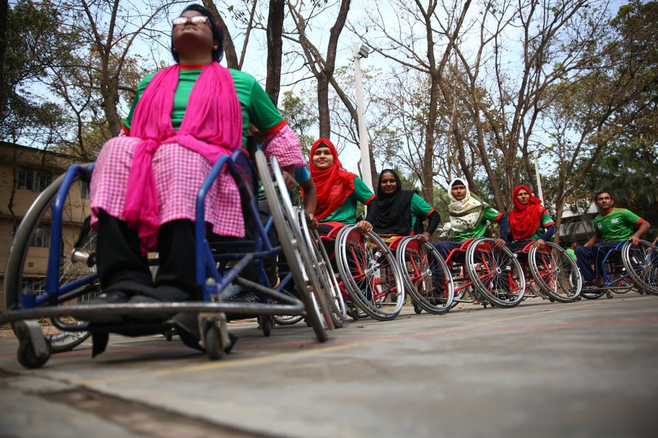 Disabled Bangladeshi women play basketball during a match in Savar on the outskirts of