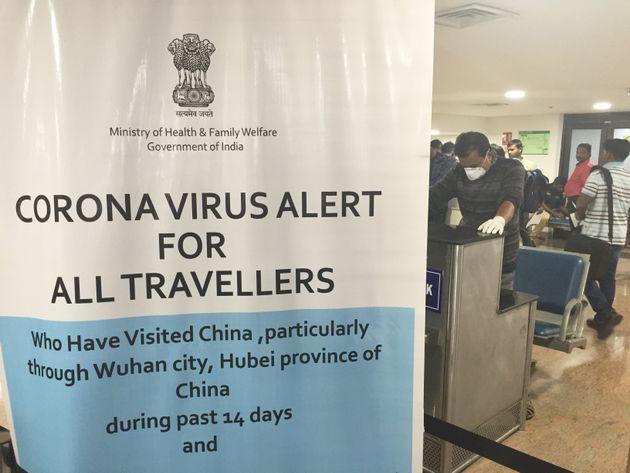 Sign warning travelers about the coronavirus at Trivandrum International Airport in Thiruvananthapuram...