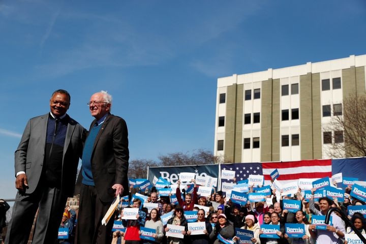 Civil rights activist Rev. Jesse Jackson stands on stage after endorsing presidential candidate Bernie Sanders at a rally in