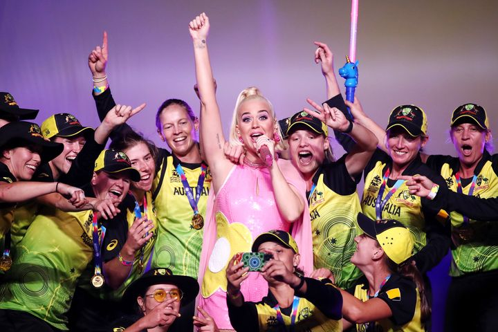 Katy Perry performs on stage with the Australian team during a concert after their victory in the ICC Women's T20 Cricket World Cup Final match between India and Australia at the Melbourne Cricket Ground on March 08, 2020 in Melbourne, Australia.