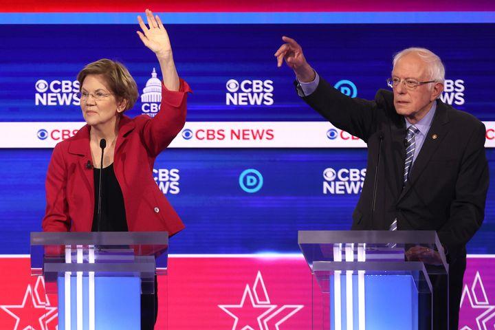 Sen. Elizabeth Warren (D-Mass.), left, and Sen. Bernie Sanders (I-Vt.) appear on the debate stage in Charleston, S.C. Some of