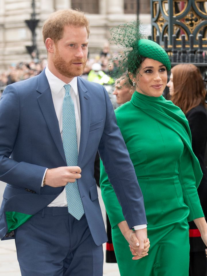 The lining of Harry's suit is green, matching Meghan's ensemble.