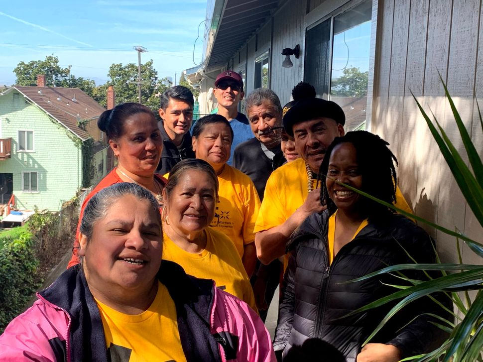 Perez with some of his fellow rent strikers and ACCE staff including Israel Lepiz (pictured back, left) and ACCE Oakland dire