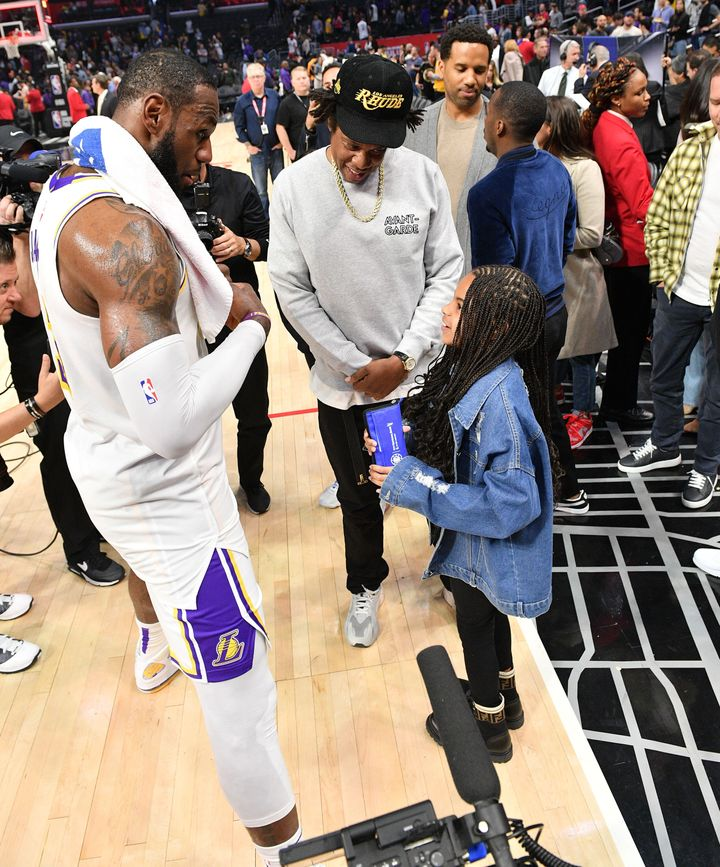 LeBron James and Blue Ivy have a chat as Jay-Z looks on.
