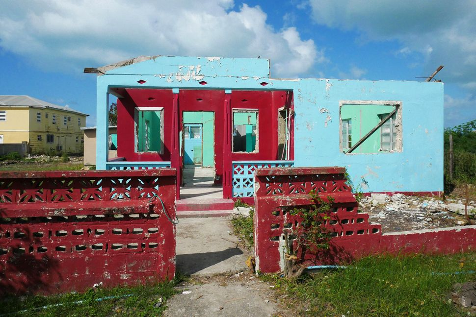 Hurricane Irma destroyed 95% of the island's buildings and infrastructure in September 2017. Sights like this one of de