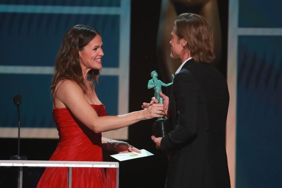 Brad Pitt accepts his award from Jennifer Garner onstage during the 26th Annual Screen Actors Guild Awards on Jan. 19, 2