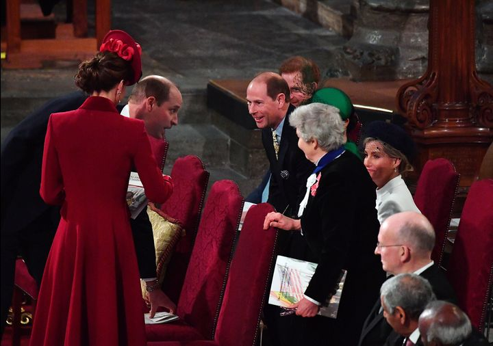 Prince William and Prince Edward appear to exchange greetings.