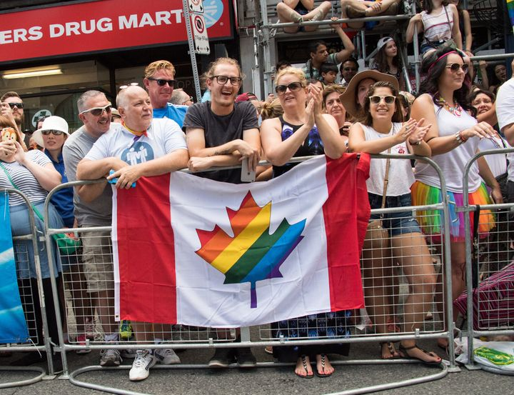 File photo of Canada's flag with a maple leaf full of rainbow colours.