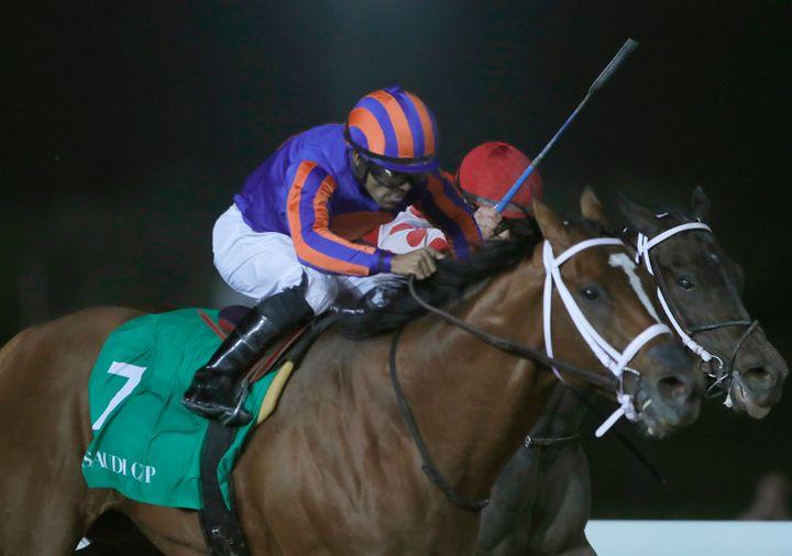 Jockey Luis Saez rides Maximum Security near the finish line of the $20 million Saudi Cup at King Abdul Aziz race track in Ri