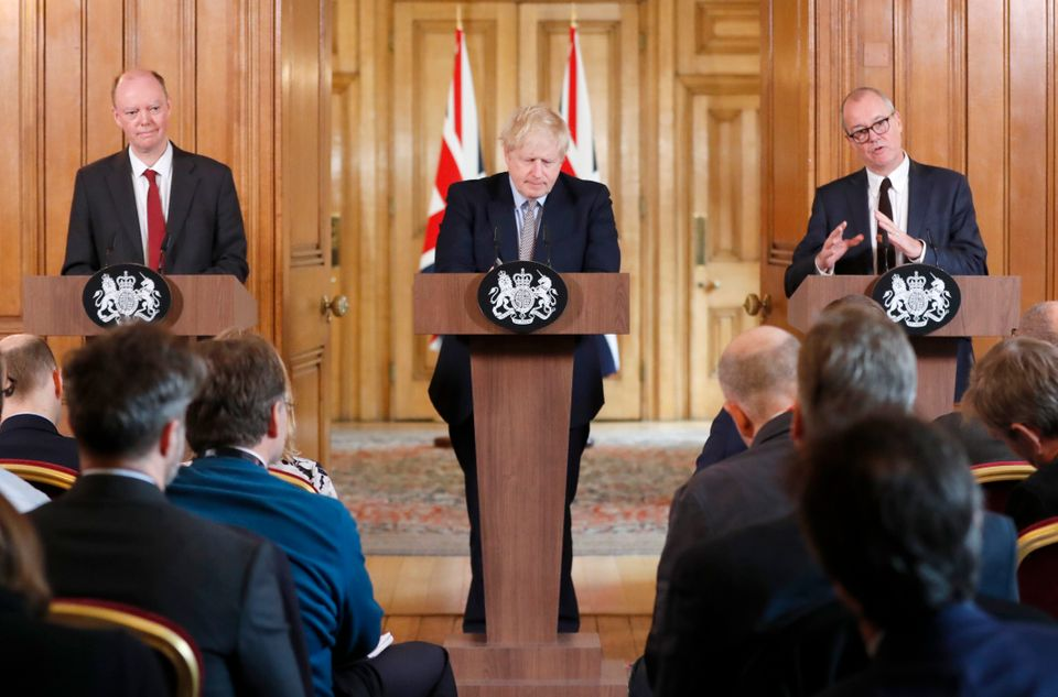 British PM Boris Johnson, centre, Chief Medical Officer for England Chris Whitty, left, and Chief Scientific...