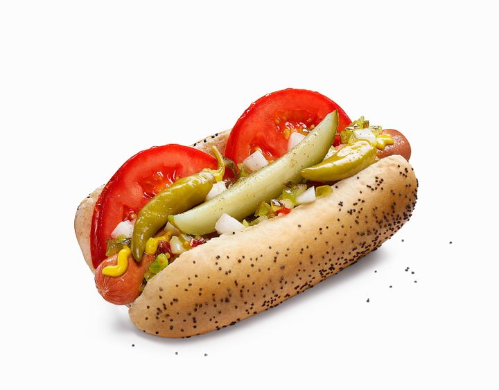 A Chicago-style hot dog, served on a traditional poppyseed roll.
