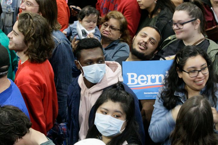 Some supporters wore face masks as they attended a campaign rally for Democratic presidential contender Sen. Bernie Sanders i