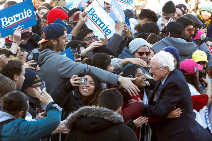 Sanders got a hug as he worked the crowd after a campaign rally in Chicago's Grant Park on Saturday.