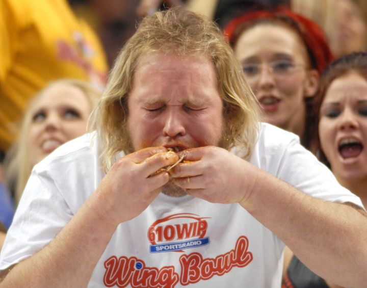 PHILADELPHIA - JANUARY 30:  Douglas 'Obi WIng' Petock stuffs his mouth with Buffalo Wings during Wing Bowl 17 at the Wachovia