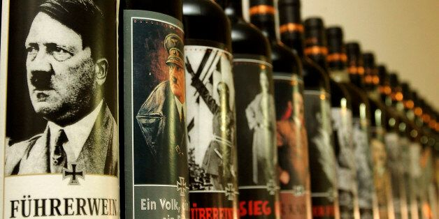 UDINE, ITALY- SEPTEMBER, 12: Bottles of wine with labels depicting Nazi leader Adolf Hitler sit on a shelf in the cellar of '