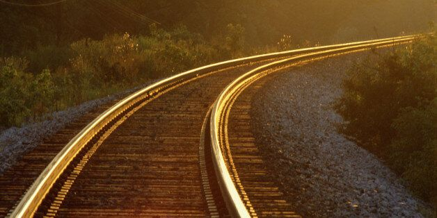 Evening light shining on railway track