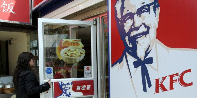 FILE - In this Thursday, March 29, 2007, file photo, customers walk in to a KFC restaurant in Shanghai, China.  The owner of