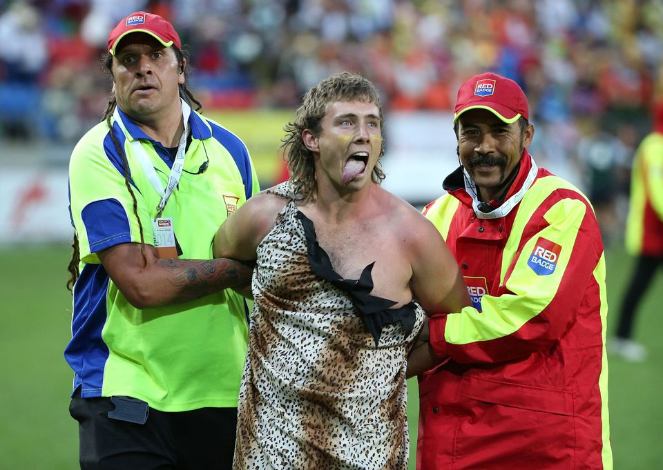 WELLINGTON, NEW ZEALAND - FEBRUARY 07:  A spectator dressed as Tarzan is ejected from the stadium after getting onto the oute