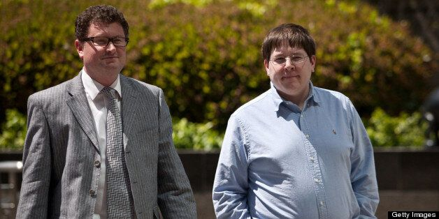 SACRAMENTO - APRIL 23: Former Reuters social media editor Matthew Keys (R) arrives at the federal courthouse April 23, 2013 in Sacramento, California. Keys was in court to face charges he conspired with the hacking group Anonymous. (Photo by Max Whittaker/Getty Images)