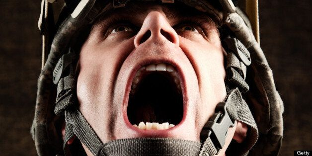 Portrait of US Military soldier screaming.