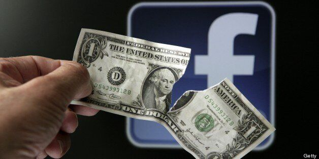 GERMANY - MAY 23: Torn dollar bill in front of the Facebook logo, symbol picture: 'The downward trend continues' - big losses