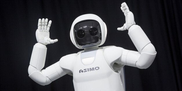 NEW YORK - APRIL 17: Honda Motors demonstrates its Asimo robot during a media preview of the 2014 New York International Auto
