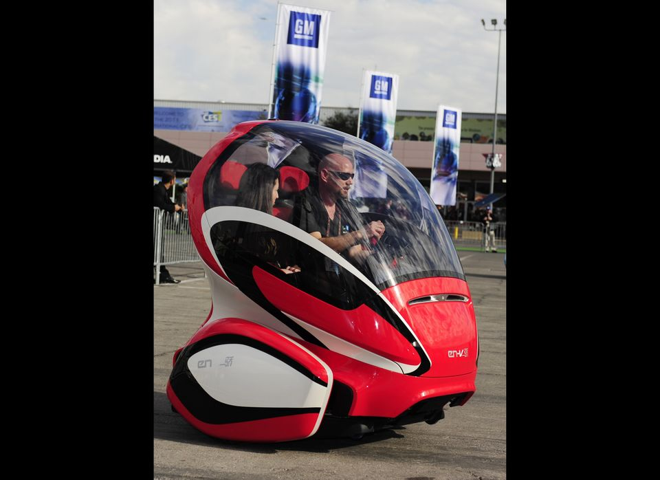 """The AP reports, """"The EN-V (Electric-Networked Vehicle) is a two-seat electric vehicle designed to address environmental issue"""