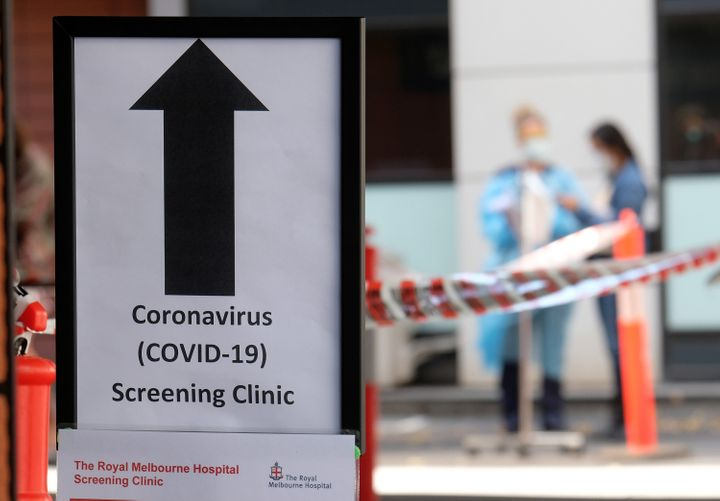 Hospital nursing staff assist people lining up for COVID-19 screening outside the Royal Melbourne Hospital on March 11 in Melbourne, Australia.