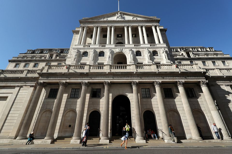 The Bank of England, in the City of London, which has announced that it has cut its main interest rate...