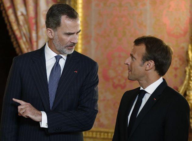 Que fait le roi d'Espagne -ici avec Emmanuel Macron à Madrid le 26 juillet 2018- à la première...