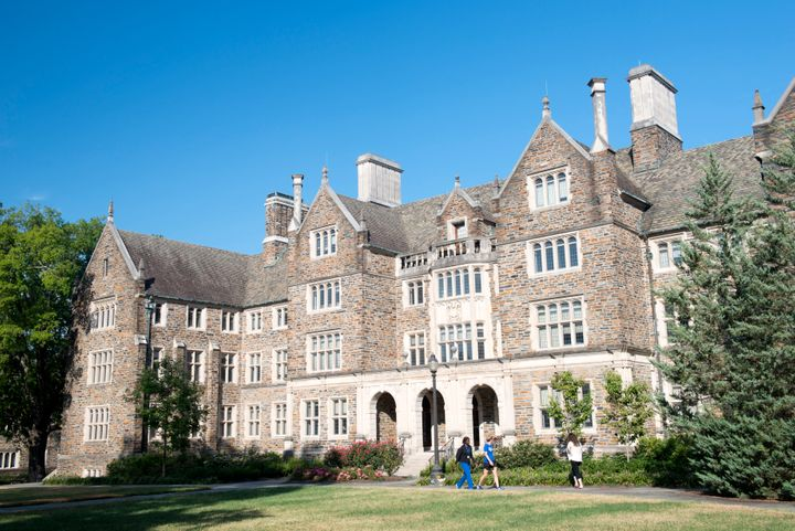 Three students walk past a dorm building on the campus of Duke University on Aug. 11, 2017.