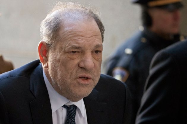 Harvey Weinstein arrives at a Manhattan court as jury deliberations continue in his rape trial, Friday,...