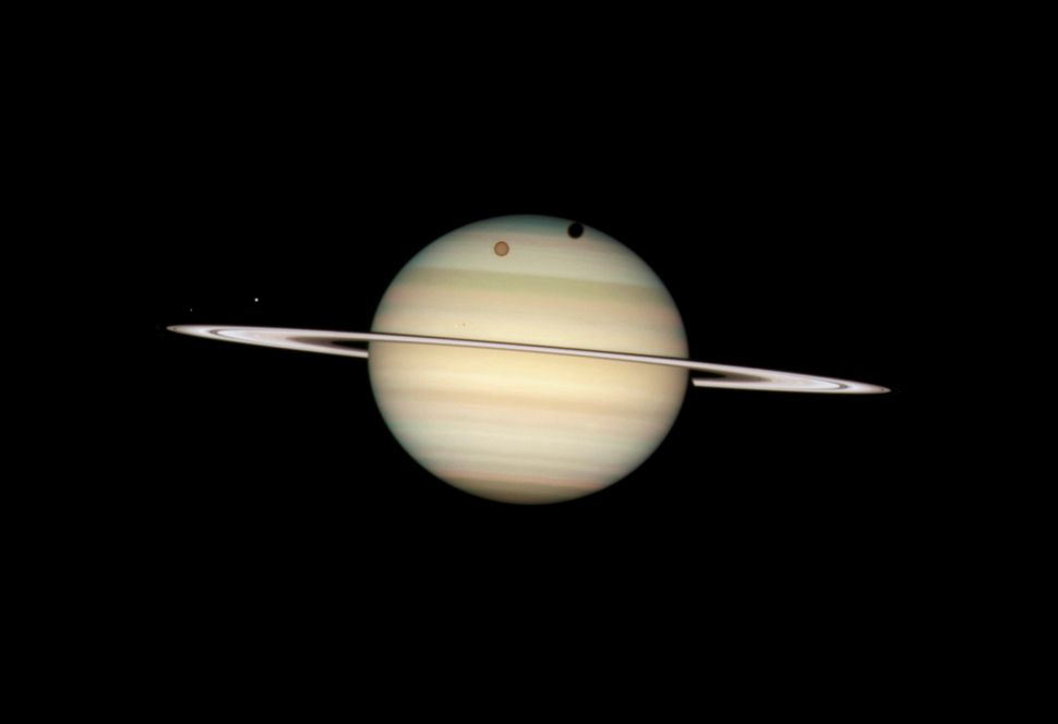 2009: Saturn Quadruple Moon Transit  Credit: NASA, ESA, and the Hubble Heritage Team (STScI/AURA) <br> <br> (Read about the i