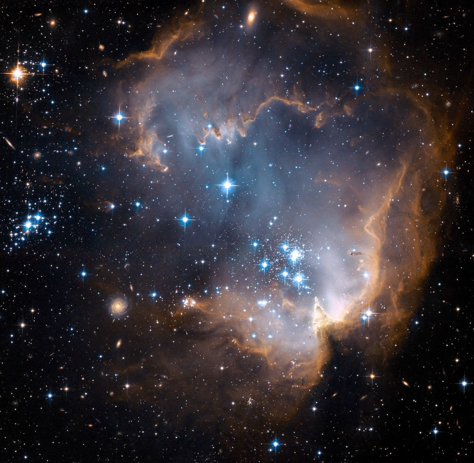 2007: NGC 602  Credit: NASA, ESA, and the Hubble Heritage Team (STScI/AURA) - ESA/Hubble Collaboration <br> <br> (Read about