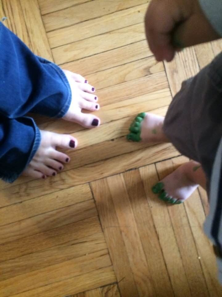 A post-pedicure photo of the author, Kat Rossi (left), and her son