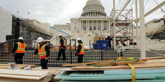 Workers construct the viewing stands ahead of U.S. President-elect Donald Trump's January inauguration at the U.S. Capitol in