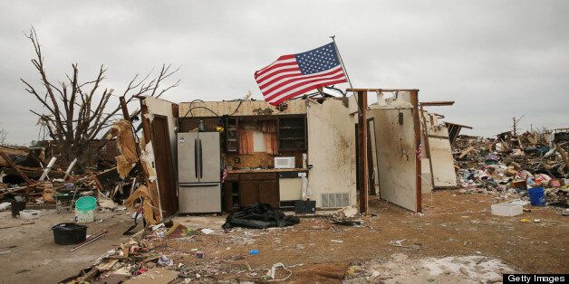 MOORE, OK - MAY 26:  Part of the kitchen is all that remains in the debris of a home destroyed by a tornado on May 25, 2013 i