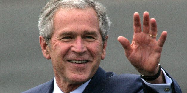 UNITED KINGDOM - JUNE 16:  U.S. President George W. Bush waves upon arrival at RAF Aldgerove in Belfast, Northern Ireland, on
