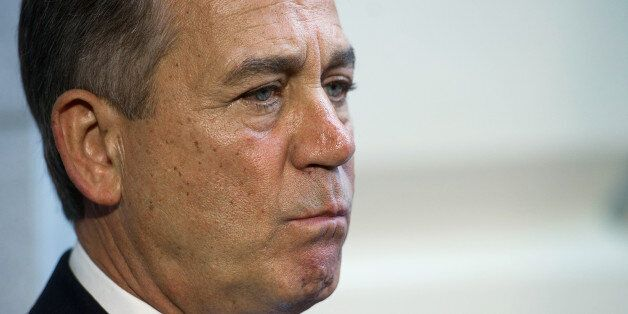 Speaker of the House John Boehner, R-Ohio, listens as house republican leadership speaks with the press after a House Republi