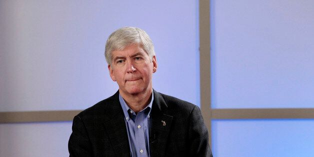 Rick Snyder, governor of Michigan, listens at a public meeting in Detroit, Michigan, U.S., on Friday, March 1, 2013. Snyder s