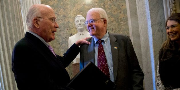 UNITED STATES - JANUARY 22:  Sen. Pat Leahy, D-Vt., left, talks with Rep. Jim Sensenbrenner, R-Wisc., before the senate lunch
